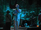 R.E.M. broke into the musical mainstream with     college radio airplay, touring, and a grassroots fanbase.