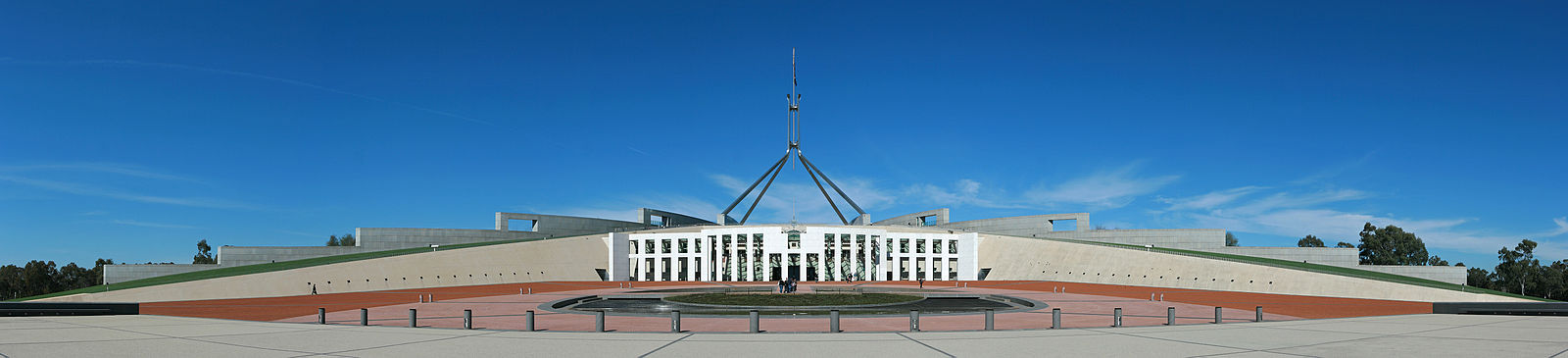 New Parliament House, opened in 1988, was built into Capital Hill behind Old Parliament House Parliament House, Canberra, Pano jjron 25.9.2008-edit1.jpg
