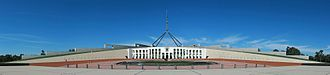 Parliament of Australia - New Parliament House, opened in 1988, was built into Capital Hill behind Old Parliament House