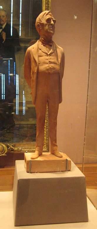 Robert Lowe - A terracotta statuette dated 1873 by caricaturist Carlo Pellegrini of Lowe standing on a box of matches inscribed 'Ex luce lucellum'