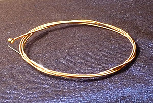 "String (music) - A wound acoustic guitar string (phosphor bronze wound around steel) with a ball end, 0.044"" gauge"