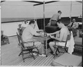 Photograph of members of President Truman's vacation party relaxing on the deck of the President's yacht, the U.S.S.... - NARA - 199027.tif