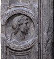 Piazza cattaneo, portale in pietra nera con medaglioni di imperatori e fregio con girali, delfini, e putti reggistemma, xvi secolo 07.jpg