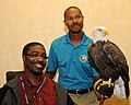 Posing for picture with Bald Eagle. (10594303473).jpg