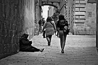 A woman begging in Carrer del Bisbe, Barcelona, Spain. Poverty-1274179 960 720.jpg