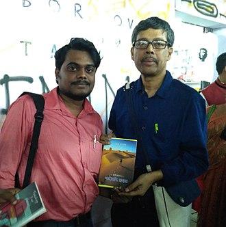 Kolkata Book Fair - Pracheta Gupta (right) and Suman Sen holding Sen's novel Sarpa Manav: Nagmoni Rohosyo at Kolkata Book Fair 2018.
