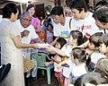 President Gloria Macapagal-Arroyo leads the feeding program for the malnourished children.jpg