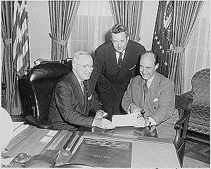 Checkers speech - President Harry Truman (left, seated) meets with Gov. Adlai Stevenson (right, seated) and Sen. John Sparkman