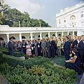 President John F. Kennedy greets the first group of Peace Corps Volunteers going to Tanganyika and Ghana, in the White House Rose Garden - KN-C18661-B.jpg