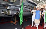 Prime Minister Narendra Modi being explained about the weapon load of MiG 29 K Aircraft in the Hangar of INS Vikramaditya.jPG