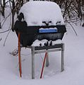 Propane gas grill in the snow - closeup.jpeg