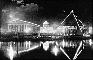 Tennessee Centennial and International Exposition - The Nashville and Memphis pavilions at night, seen over Watauga Lake, with the Commerce Building at rear.