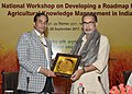 Radha Mohan Singh being presented a memento by the Secretary, Department of Agricultural Research and Education (DARE) and DG, ICAR, Dr. T. Mohapatra.jpg