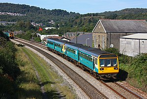 Rhondda line - A pair of Arriva Trains Wales Class 142s at Treforest, with a Class 150 on the opposite line in the background.