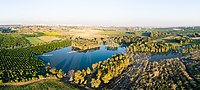 Rehovot winter puddle panorama from the air.jpg