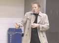 Rick Astley impersonator rickrolling a basketball game.png