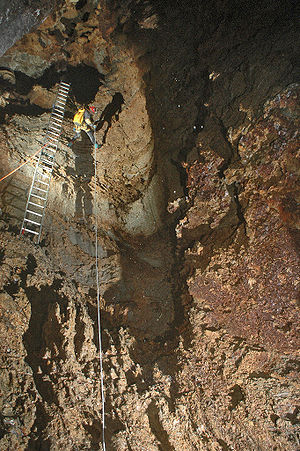 Ladder - A coilable aluminium ladder being used in Riverbend Cave, 2006