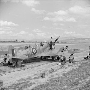 No. 154 Squadron RAF - Ground crew servicing a Supermarine Spitfire of No. 154 Squadron in its dispersal at Souk el Khemis ('Victoria'), Tunisia.