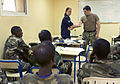 Royal Netherlands Navy Cpl. Kim Schild, top left, demonstrates methods to control bleeding to Djiboutian, Sudanese and Rwandan service members during exercise Cutlass Express 2013 at the Port of Djibouti 131113-F-NJ596-018.jpg