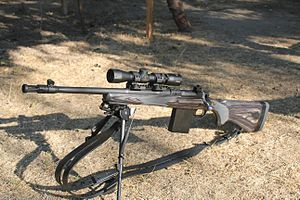 "Ruger Gunsite Scout - Ruger Gunsite Scout chambered in .308 Win. The gun is the left-handed black 16.5"" model with the Burris Scout Scope, Harris Bipod and Galco Safari Ching Sling."