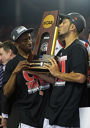 Russ Smith (basketball) - Smith (left) and Peyton Siva (right) with the 2013 NCAA Men's Division I Basketball Tournament trophy.