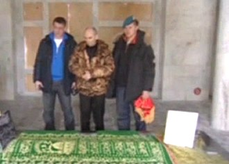 Ahmad Shah Massoud - Group of former Soviet military men, led by Col. Leonid Khabarov (center,) standing by the Massoud's Tomb, commemorating his memory (2009)