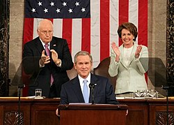 President George W. Bush with Vice President Dick Cheney and House Speaker Nancy Pelosi during the 2007 State of the Union address. Note the tinted transparent teleprompters.