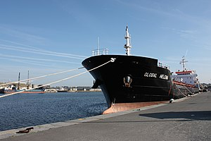 English: The cargo Global Helena in the harbou...