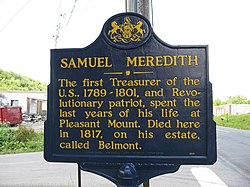 "Blue sign reads ""SAMUEL MEREDITH: The first Treasurer of the U.S., 1789-1801, and Revolutionary patriot, spent the last years of his life at Pleasant Mount. Died here in 1817, on his estate, called Belmont."""