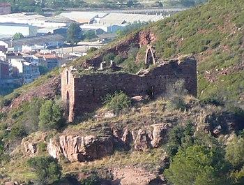 Sant Genís de Rocafort visto desde la sierra de l'Ataix, con Martorell al fondo.