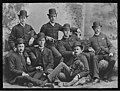 Seven men and a dog, Seattle, 1886 (MOHAI 1611).jpg