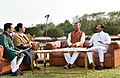 Shripad Yesso Naik along with the Chief Minister of Uttarakhand, Shri Trivendra Singh Rawat at a Yoga Day special show, on the eve of the 4th International Day of Yoga 2018, at the Forest Research Institute, in Dehradun.JPG