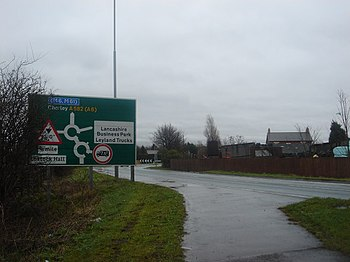 English: Sign for double roundabout at Faringt...