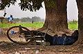 Sleeping man in Ouagadougou.jpg