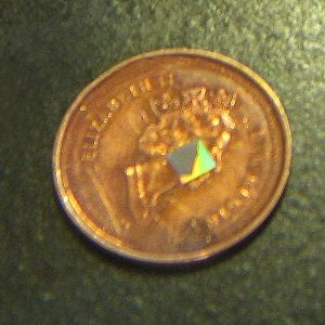 Contactless smart card - Size comparison of chip compared to a Canadian penny