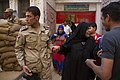 Soldier helps a woman at a polling station in Cairo - 27-May-2014.jpg