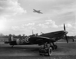 Aircraft engine starting - A Supermarine Spitfire at readiness with a trolley accumulator connected