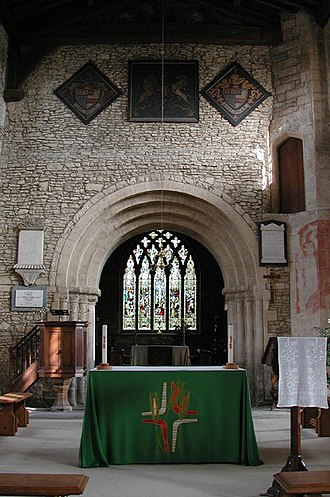 Hanslope - The chancel arch of St. James the Great parish church is Norman. The five-light east window is 13th century but its present intersecting tracery is a modern replacement.