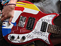 Steve Keene-painted, autographed, First Act electric guitar body 2.jpg