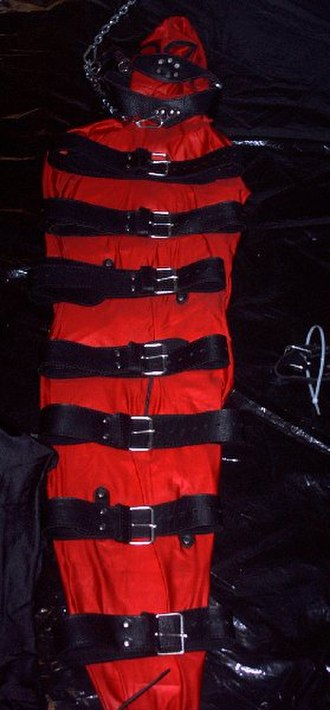 Self-bondage - Preparation of a strict self-bondage with leather belts and a special version of a lycra bodybag