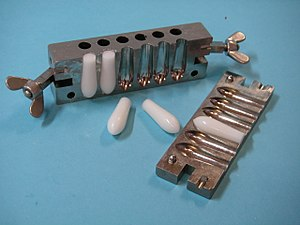 Suppository casting mould. Used by pharmacists...