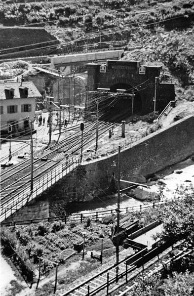 A 1958 view of the northern portal of the Gotthard Tunnel at Goschenen (Unterwalden), on the main line to Bellinzona and Italy from Luzern, Zürich etc. The line in the foreground is the branch to Andermatt.