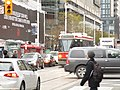 TTC streetcar visible by Dundas Square, 2015 12 01 (9) (22851619384).jpg
