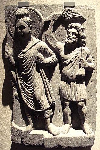 Vajrapani - The Buddha with his protector Vajrapāni. Gandhara, 2nd century