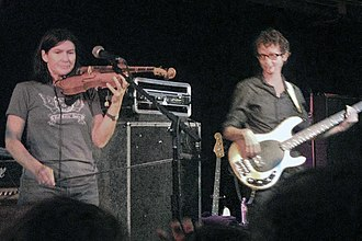 Josephine Wiggs - Wiggs (right) and Kelley Deal performing as The Breeders in 2009