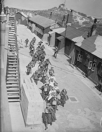 Crosby Battery - ATS girls and gun crews of 177 Heavy Battery Royal Artillery rush to 'take post' at Fort Crosby near Liverpool, England. This training operation formed part of British preparations to repel the threatened German invasion of 1940 (IWM H2696)