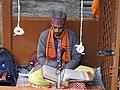 The Hindu priest reciting prayer at Laxminarayan temple ,Chamba. 04.jpg