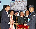 The Minister of State for Defence, Dr. Subhash Ramrao Bhamre lighting the lamp to inaugurate the Armed Forces Veterans' Day celebration, in New Delhi.jpg