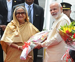 The Prime Minister, Shri Narendra Modi welcomes the Prime Minister of Bangladesh, Ms. Sheikh Hasina, on her arrival, at Air Force Station Palam, in New Delhi on April 07, 2017