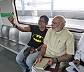 The Prime Minister, Shri Narendra Modi with the co-passenger while travelling by the Delhi Metro to Faridabad on September 06, 2015.jpg